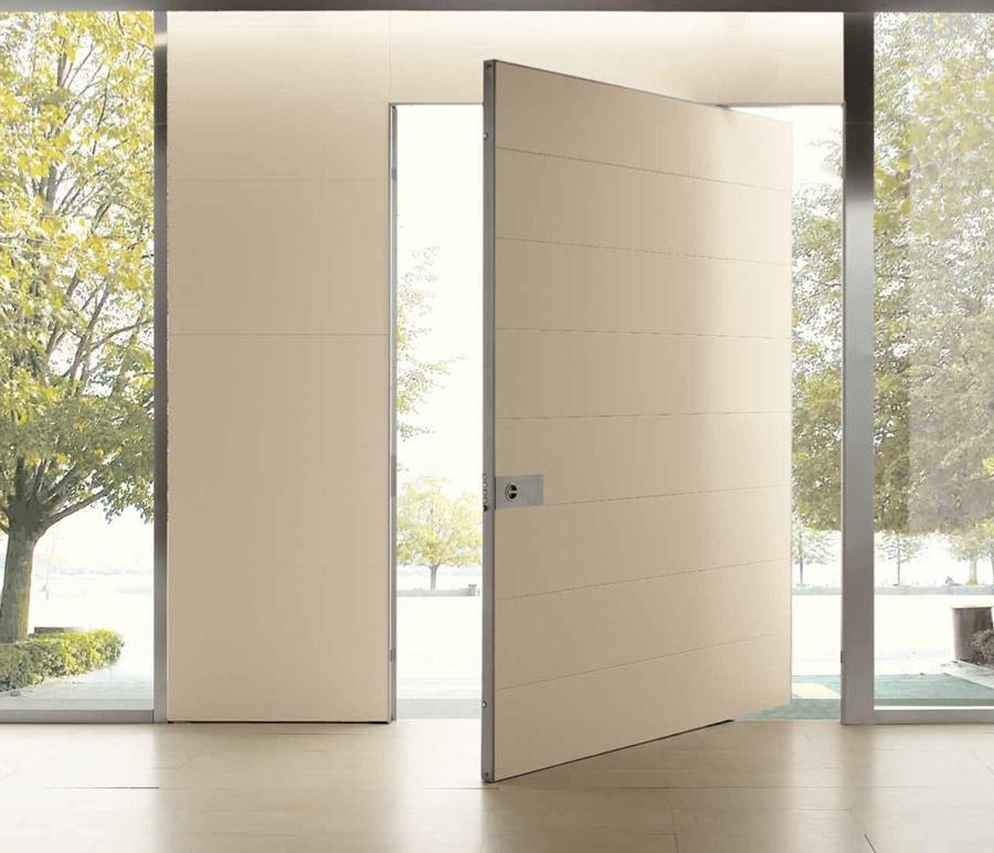 Puertas pivotantes de eje vertical. Puertas Oikos Synua 22 900x772 c